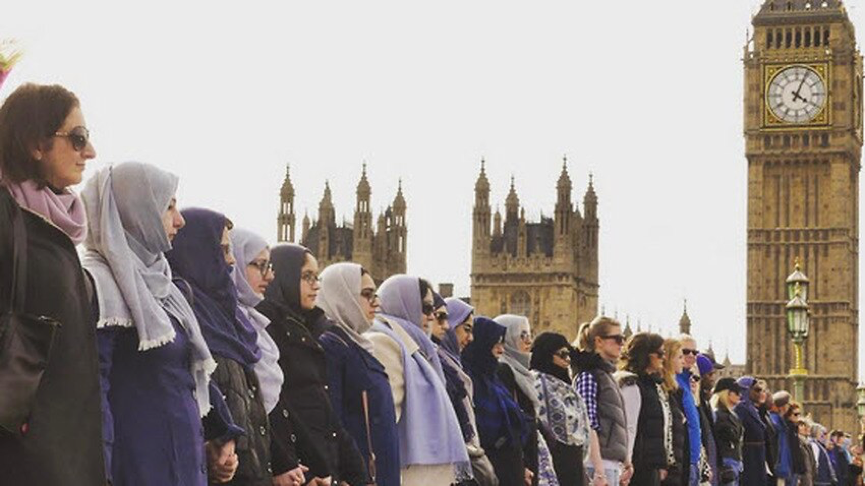 Women link hands on Westminster Bridge to remember victims